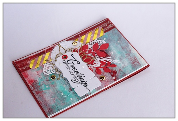 Mixed Media Christmas card with a background made with acrylic paint